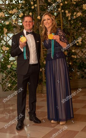 Stock Photo of US Olympic Gold Medalists John Shuster and Meghan Duggan arrive for the state dinner for French President Emmanuel Macron and his wife Brigitte Macron in the State Dining Room of the White House.