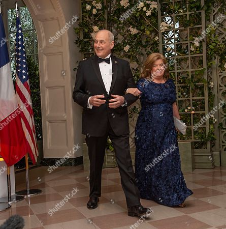 White House Chief of Staff John F. Kelly and Mrs. Karen Kelly arrive for the state dinner for French President Emmanuel Macron and his wife Brigitte Macron in the State Dining Room of the White House.