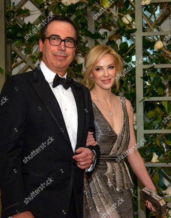 Stock Image of United States Secretary of the Treasury Steven Mnuchin and Ms. Louise Linton arrive for the State Dinner honoring Dinner honoring President Emmanuel Macron of the French Republic and Mrs. Brigitte Macron at the White House in Washington, DC.