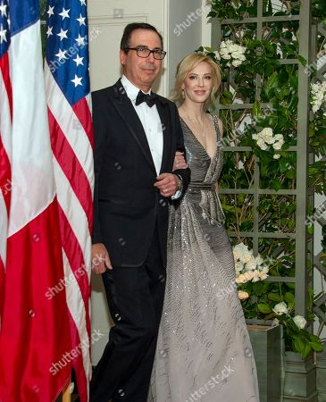 Stock Photo of United States Secretary of the Treasury Steven Mnuchin and Ms. Louise Linton arrive for the State Dinner honoring Dinner honoring President Emmanuel Macron of the French Republic and Mrs. Brigitte Macron at the White House in Washington, DC.