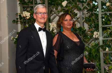 Tim Cook, Chief Executive Officer of Apple Inc. and Lisa Jackson, former Administrator of the United States Environmental Protection Agency, arrive for the State Dinner honoring Dinner honoring President Emmanuel Macron of the French Republic and Mrs. Brigitte Macron at the White House