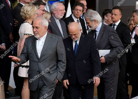 Mohammad Javad Zarif (first row, L), the Foreign Minister of Iran, and Ibrahim Al Jaafari (first row, C), his Irakian counterpart, arrive for a family photo during a conference on 'Supporting the future of Syria and the region' at EU council headquarters, in Brussels, Belgium, 25 April 2018.