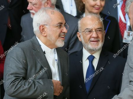 Mohammad Javad Zarif, the Foreign Minister of Iran and Ibrahim Al Jaafari, his Irakian counterpart take part at a family picture during a conference on 'Supporting the future of Syria and the region' at EU council headquarters, in Brussels, Belgium, 25 April 2018.