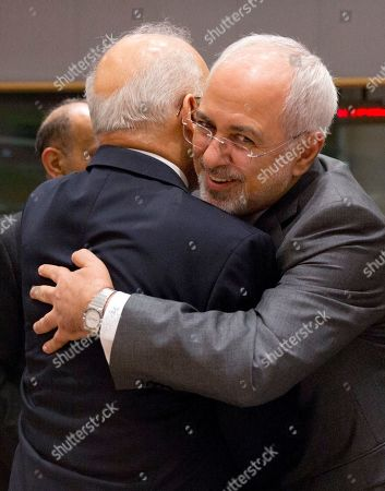 Iranian Foreign Minister Mohammad Javad Zarif, right, greets Iraq's Foreign Minister Ibrahim al-Jaafari as they attend a conference 'Supporting the future of Syria and the region' at the Europa building in Brussels on