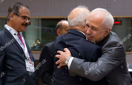Iranian Foreign Minister Mohammad Javad Zarif, right, greets Iraq's Foreign Minister Ibrahim al-Jaafari, center, as they attend a conference 'Supporting the future of Syria and the region' at the Europa building in Brussels on