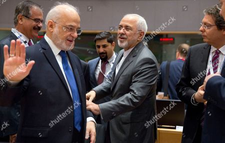 Iranian Foreign Minister Mohammad Javad Zarif, center, greets Iraq's Foreign Minister Ibrahim al-Jaafari, second left, as they attend a conference 'Supporting the future of Syria and the region' at the Europa building in Brussels on