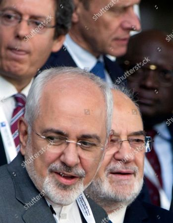Iranian Foreign Minister Mohammad Javad Zarif, front left, and Iraq's Foreign Minister Ibrahim al-Jaafari, front right, wait for the start of a group photo at a conference 'Supporting the future of Syria and the region' at the Europa building in Brussels on . EU foreign policy chief Federica Mogherini is calling on Russia, Iran and Turkey to force a halt to fighting in Syria, as international donors gather in Brussels to drum up aid for the conflict-ravaged country
