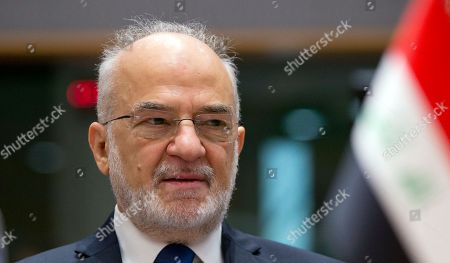 Iraq's Foreign Minister Ibrahim al-Jaafari waits for the start of a conference 'Supporting the future of Syria and the region' at the Europa building in Brussels on . EU foreign policy chief Federica Mogherini is calling on Russia, Iran and Turkey to force a halt to fighting in Syria, as international donors gather in Brussels to drum up aid for the conflict-ravaged country