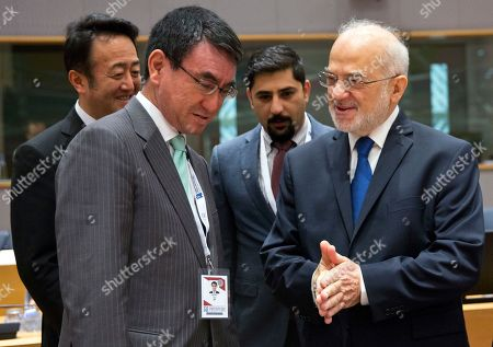 Iraq's Minister for Foreign Affairs Ibrahim al-Jaafari, right, speaks with Japan's Minister for Foreign Affairs Taro Kono during a conference 'Supporting the future of Syria and the region' at the Europa building in Brussels on . EU foreign policy chief Federica Mogherini is calling on Russia, Iran and Turkey to force a halt to fighting in Syria, as international donors gather in Brussels to drum up aid for the conflict-ravaged country
