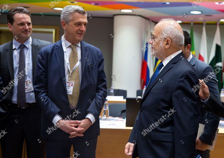 Iraq's Minister for Foreign Affairs Ibrahim al-Jaafari, right, speaks with UN High Commissioner for Refugees Filippo Grandi, second left, during a conference 'Supporting the future of Syria and the region' at the Europa building in Brussels on . EU foreign policy chief Federica Mogherini is calling on Russia, Iran and Turkey to force a halt to fighting in Syria, as international donors gather in Brussels to drum up aid for the conflict-ravaged country