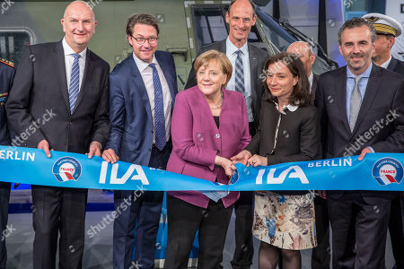 (L-4R front) Minister President of Brandenburg Dietmar Woidke, German Minister of Transportation Andreas Scheuer, German Chancellor Angela Merkel and French Junior Minister for Economy Delphine Geny-Stephann open the ILA Berlin Air Show 2018  in Selchow, Germany, 25 April 2018. The aerospace and defense industry exhibition takes place at the inactive Berlin-Brandenburg airport from 25 April 25 to the 29 April, 2018.