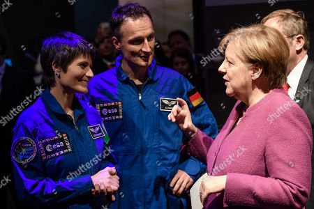 German Chancellor Angela Merkel (R) talks to Italian European Space Agency astronauts Samantha Cristoforetti (L) and German Matthias Maurer during the ILA Berlin Air Show 2018 in Selchow, Germany, 25 April 2018. The aerospace and defense industry exhibition takes place at the inactive Berlin-Brandenburg airport from 25 April 25 to the 29 April, 2018.