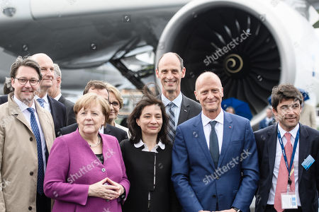 German Chancellor Angela Merkel (3-L), German Minister of Transport and Digital Infrastructure Andreas Scheuer (L), the state premier of Brandenburg Dietmar Woidke (2-L) and French Junior Minister for Economy Delphine Geny-Stephann (7-L) in front of a turbine of an Airbus A350 at the ILA Berlin Air Show 2018 in Selchow, Germany, 25 April 2018. The aerospace and defense industry exhibition takes place at the inactive Berlin-Brandenburg airport from 25 April 25 to the 29 April, 2018.