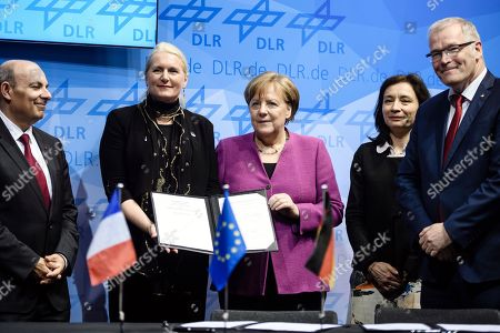 (L-R) President and Chairman of the Board of the European Aerospace and Defence Industries Association (ASD) and President of the French Aerospace Industries Association (GIFAS) Eric Trappier, Chair of the German Aerospace Center (DLR) Executive Board Pascale Ehrenfreund, German Chancellor Angela Merkel, French Junior Minister for Economy Delphine Geny-Stephann and Executive board member for Aeronautics, German Aerospace Center (DLR) Rolf Henke pose after signing a purchase agreement for a test aircraft iSTAR during the ILA Berlin Air Show 2018 in Selchow, Germany, 25 April 2018. The aerospace and defense industry exhibition takes place at the inactive Berlin-Brandenburg airport from 25 April 25 to 29 April 2018.