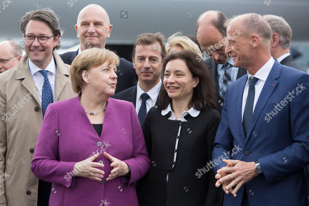 (L-R) German Minister of Transportation Andreas Scheuer, Minister President of Brandenburg Dietmar Woidke, German Chancellor Angela Merkel, French Junior Minister for Economy Delphine Geny-Stephann, Airbus CEO Tom Enders at the ILA Berlin Air Show 2018 in Selchow, Germany, 25 April 2018. The aerospace and defense industry exhibition takes place at the inactive Berlin-Brandenburg airport from 25 April 25 to the 29 April, 2018.