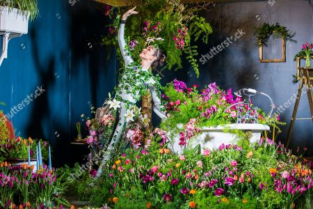 Harrogate flower show yorkshire stock photos exclusive shutterstock dancer alison parsons wears a flower dress in bathroom of the green house display at this mightylinksfo