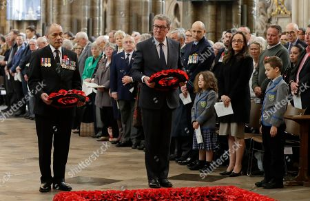 New Zealand High Commissioner Jerry Mateparae, left, and Australian High Commissioner Alexander Downer lay wreaths during a Service of Thanksgiving and Commemoration on ANZAC Day at Westminster Abbey in London