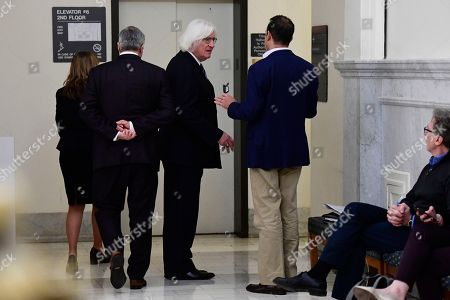 Tom Mesereau, center, lawyer for actor and comedian Bill Cosby, talks in the hall during a break in the Bill Cosby sexual assault trial at the Montgomery County Courthouse, in Norristown, Pa