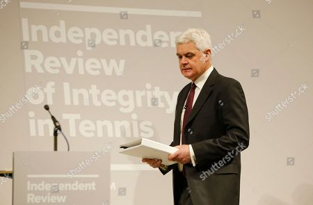 Lawyer Adam Lewis walks to the podium to speak to the media during a press conference at he launch of the Independent Review of Integrity in Tennis interim report in London, . Lewis is one of three members of the panel along with Beth Wilkinson and Marc Henzelin