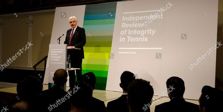"""Lawyer Adam Lewis answers a question from the media during a press conference at the launch of the Independent Review of Integrity in Tennis interim report in London, . An independent panel's two-year review of corruption in tennis has found that the sport """"faces a serious integrity problem"""" at its lowest levels ? a """"tsunami,"""" according to one investigator ? but no widespread problem at ATP, WTA and Grand Slam tournaments"""