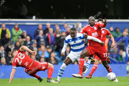 Bright Osayi-Samuel (C) of Queens Park Rangers and Michael Morrison (L) and Cheikh Ndoye (R) of Birmingham City in action during the Sky Bet Championship match between Queens Park Rangers and Birmingham City at Loftus Road Stadium in London. 28 Apr 2018