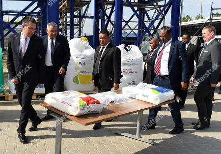 President of the Federal Democratic Republic of Ethiopia Mulatu Teshome Wirtu (C), President of the Management Board of the Pulawy chemical plant Jacek Janiszek (2-L) and his deputy Andrzej Skwarek (L) during a visit to the Pulawy chemical plant in Pulawy, east Poland, 25 April 2018. President of Ethiopia continues his two-day official visit to Poland.