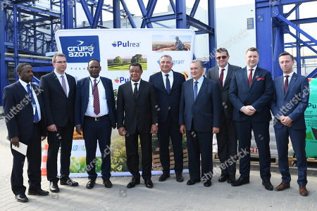 President of the Federal Democratic Republic of Ethiopia Mulatu Teshome Wirtu (4-L), President of the Management Board of the Pulawy chemical plant Jacek Janiszek (5-L) and his deputy Andrzej Skwarek (2-L) pose for a photo during a visit to the Pulawy chemical plant in Pulawy, east Poland, 25 April 2018. President of Ethiopia continues his two-day official visit to Poland.
