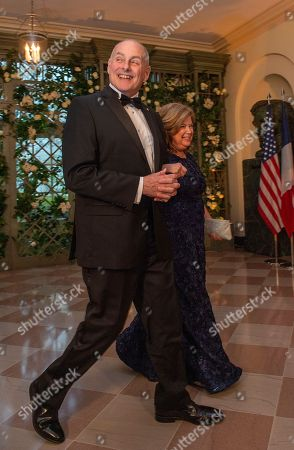 White House Chief of Staff John Kelly and Mrs. Karen Kelly arrive for the State Dinner