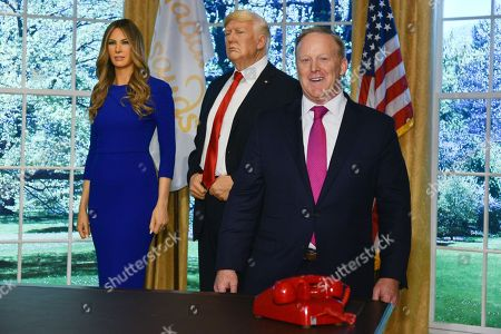 Sean Spicer with Madame Tussauds figures of Melania Trump and Donald Trump