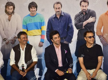 Indian film director Rajkumar Hirani, actor Ranbir Kapoor with producer Vidhu Vinod Chopra