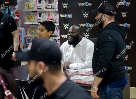 Professional wrestler Mark Henry poses for fans during a signing posters ceremony in Jiddah, Saudi Arabia, two days before the Greatest Royal Rumble will kick off