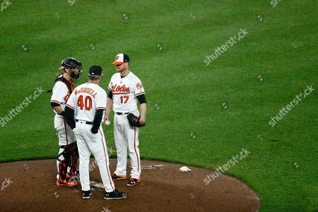 Roger McDowell, Chance Sisco, Alex Cobb. Baltimore Orioles pitching coach Roger McDowell (40) speaks with catcher Chance Sisco, left, and starting pitcher Alex Cobb after Tampa Bay Rays' Daniel Robertson doubled in the fifth inning of a baseball game, in Baltimore