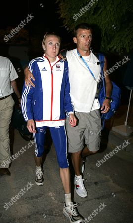 Paula Radliffe With Husband Gary Lough Leaves The Stadium After The Women's Marathon In The 2004 Olympic Games In Athens