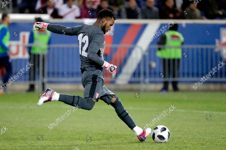 On, Peru goalkeeper Carlos Caceda clears the ball during the second half of an international friendly soccer match against Iceland, in Harrison, N.J