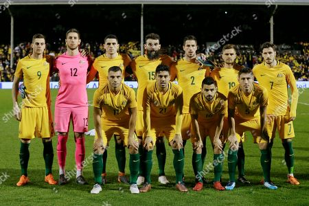Australia's, back row from left, Tomi Juric, Bradley Jones, Tom Rogic, Mile Jedinak, Milos Degenek, Josh Risdon, Mathew Leckie and, front left to right, Andrew Nabbout, Massimo Luongo, Aziz Behich, Mark Milligan, during the national anthems before a friendly soccer match between Colombia and Australia in London, Tuesday, March 27, 2018