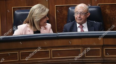 Spanish Treasure Minister, Cristobal Montoro (R), and Spanish Minister of Employment, Fatima Banez (L), attend the second session of the 2018 Budget Debate at the Lower House in Madrid, Spain, 26 April 2018. The Lower House will vote the amendments to the 2018 Budget although it all points to the rejection of these as the budget presented by the Government counts with the support of the People's Party (PP), Ciudadanos, Basque PNV, Coalicion Canaria, Foro Asturias and UPN.