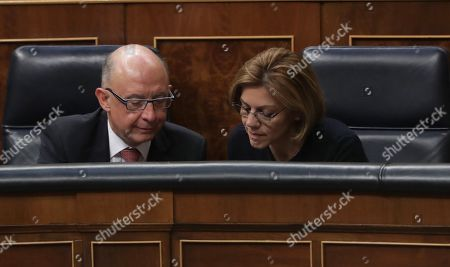 Spanish Treasure Minister, Cristobal Montoro (L), and Spanish Minister of Defense, Maria Dolores de Cospedal (R), attend the second session of the 2018 Budget Debate at the Lower House in Madrid, Spain, 26 April 2018. The Lower House will vote the amendments to the 2018 Budget although it all points to the rejection of these as the budget presented by the Government counts with the support of the People's Party (PP), Ciudadanos, Basque PNV, Coalicion Canaria, Foro Asturias and UPN.