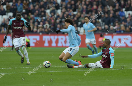 Patrice Evra of West Ham Utd tackles Leroy Sane of Manchester City during the West Ham vs Manchester City Premier League match at the London Stadium.