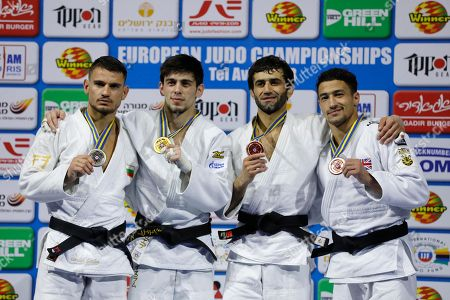 (R-L) Britain's bronze medallist Ashley Mckenzie , Russia's bronze medallist Beslan Mudranov  , Russia's gold medallist Islam Yashuev  and Bulgarian's silver medallist Yanislav Gerchev  poses for a photo after wininig at the men's  -60kg  during the   2018 European Judo Championship  in Tel Aviv, Israel , 26 April 2018.