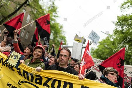 Protesters during the demonstration against the awarding of the Axel Springer Award 2018 to Amazon founder Jeff Bezos for his 'visionary entrepreneurship'