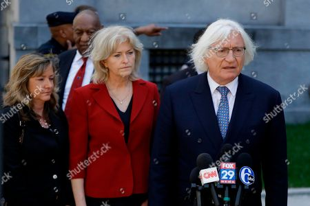 Attorneys Tom Mesereau, right, and Kathleen Bliss talk to the media after Bill Cosby's sexual assault trial, at the Montgomery County Courthouse in Norristown, Pa