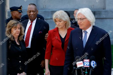 Attorneys Tom Mesereau, right, and Kathleen Bliss depart after Bill Cosby's sexual assault trial, at the Montgomery County Courthouse in Norristown, Pa