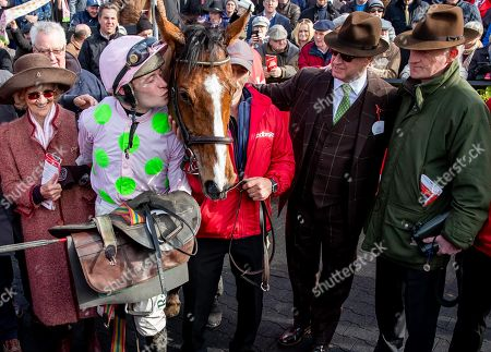 The Ladbrokes Champion Stayers Hurdle . Jockey David Mullins, owner Rich Ricci and trainer Willie Mullins celebrate after winning the race with with Faugheen