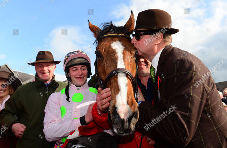 PUNCHESTOWN. Day 3. FAUGHEEN and David Mullins are greeted by an emotional RICH RICCI (right) after winning for trainer Willie Mullins (left).