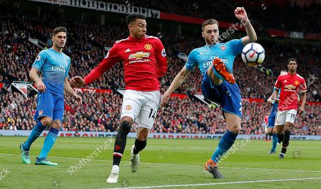 Calum Chambers of Arsenal defends the goal from Jesse Lingard of Manchester United receiving a ball