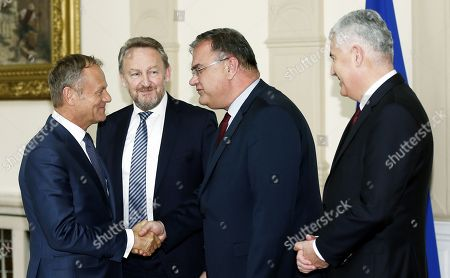 (L-R) President of the European Council Donald Tusk, shake hands with Chairman of Bosnian Presidency Bakir Izetbegovic, Member of Bosnian Presidency Mladen Ivanic and Member of Bosnian Presidency Dragan Covic during a visit in Sarajevo, Bosnia an Herzegovina, 26 April 2018. Tusk is on an official visit to Sarajevo.