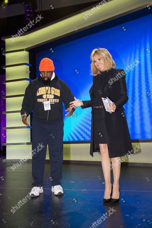 """Stock Picture of Brigitte Trogneux wife of France's President Emmanuel Macron meets with """"Mr. T"""" as she visits the Duke Ellington School of the Arts"""