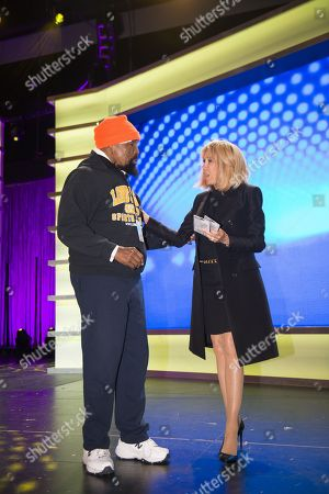 """Stock Image of Brigitte Trogneux wife of France's President Emmanuel Macron meets with """"Mr. T"""" as she visits the Duke Ellington School of the Arts"""