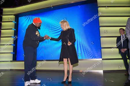 "Brigitte Trogneux wife of France's President Emmanuel Macron meets with ""Mr. T"" as she visits the Duke Ellington School of the Arts"