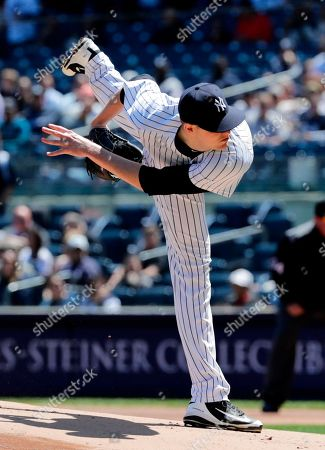 New York Yankees' Jordan Montgomery delivers a pitch during the first inning of a baseball game against the Minnesota Twins, in New York